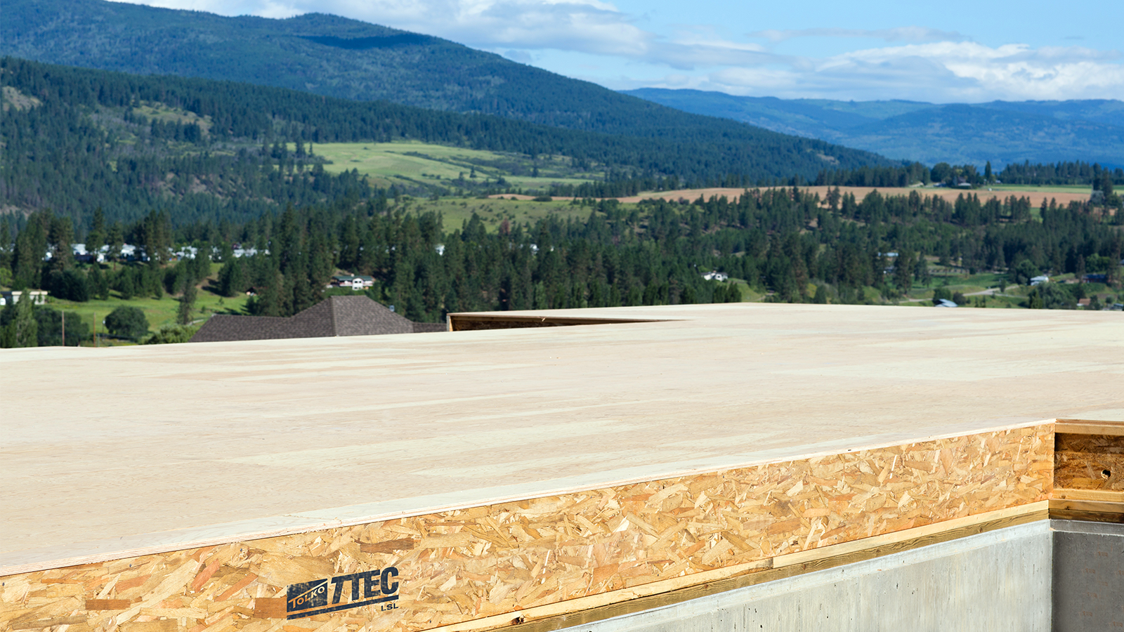 Tolko T-TEC LSL Rim Board product used at residential construction site